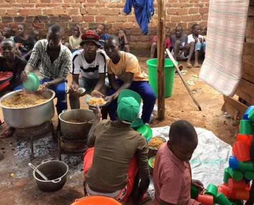 Feeding the homeless children in Uganda