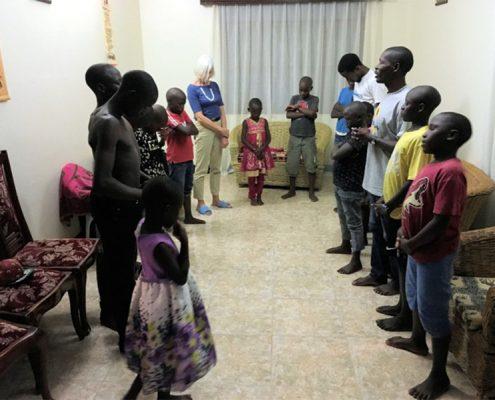 Street children praying in the New Year