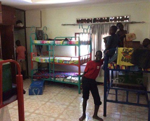 Street children tidying their bedroom
