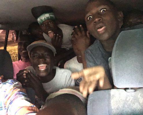 Lots of street boys in a car