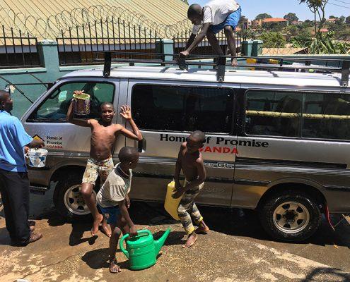 Street children cleaning the minibus