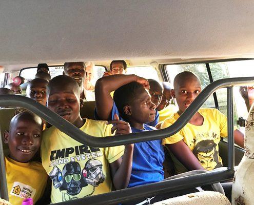 Street children and Jane in minibus