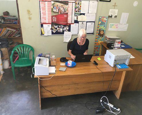 Jane working at her desk