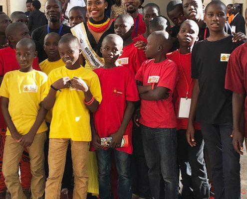 The street boys with Miss Uganda