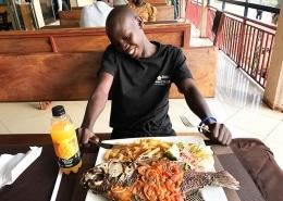 Street boy enjoying his food