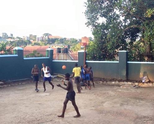 Street children playing basketball