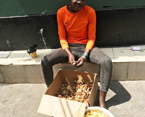 A boy peeling potatoes