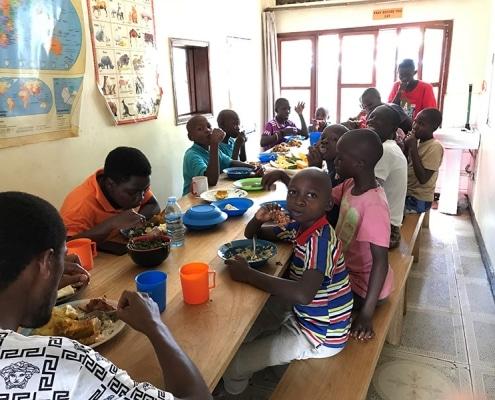 Street children enjoying lunch