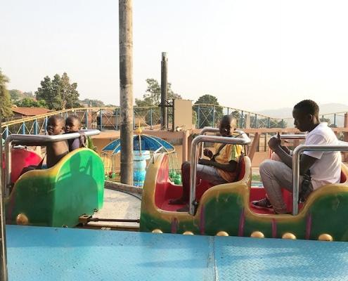 Street children on a fairground ride