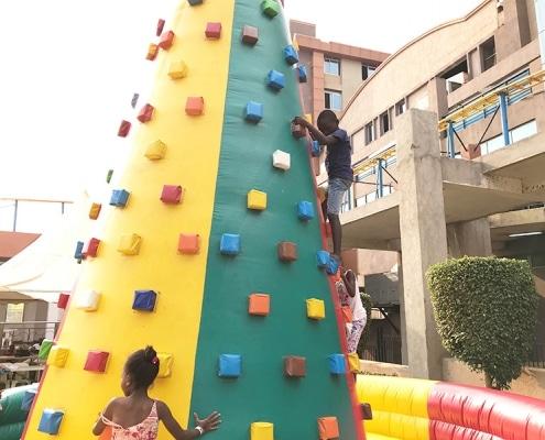 Street boy playing on a climbing wall