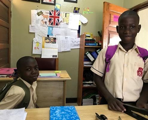 Two former street children return from school