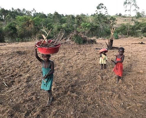 Ugandan children helping out
