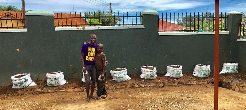 Street children planting seeds
