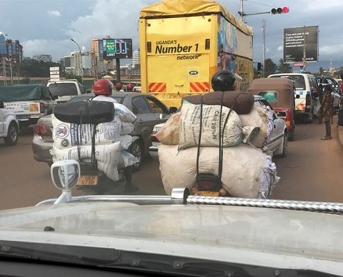 Carrying 300 kilos of flour on a body-boda