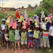Ugandan children with donated toys