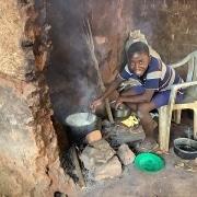 A Ugandan boy cooking lunch
