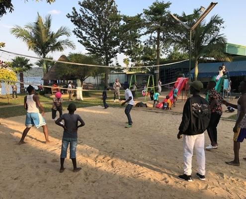 Street boys in Uganda playing volleyball