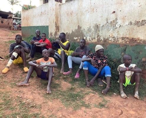 Street children watching football