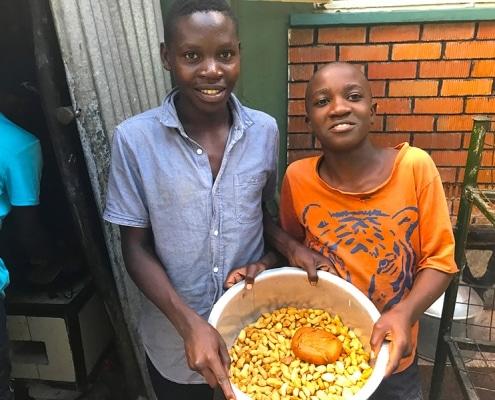 Street children cooking food