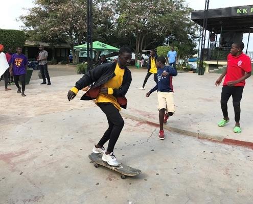 A Ugandan street boy skateboarding