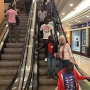 Street children using an escalator