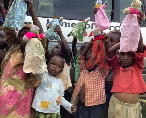 Children with donated teddies