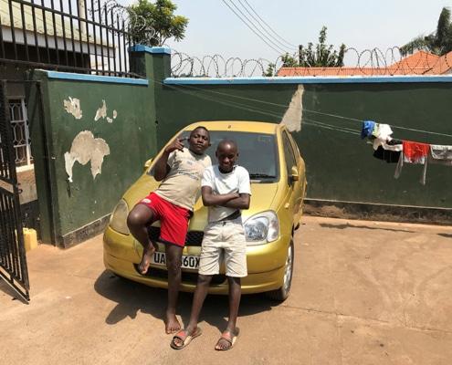 Boys posing on the car
