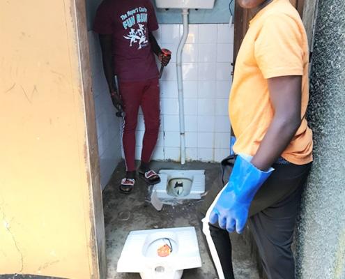 Boys repairing the toilet
