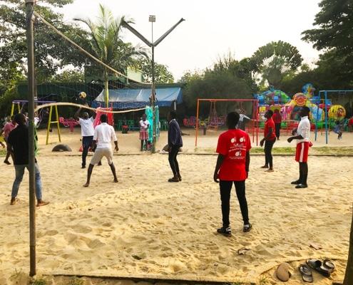 Street children playing volleyball