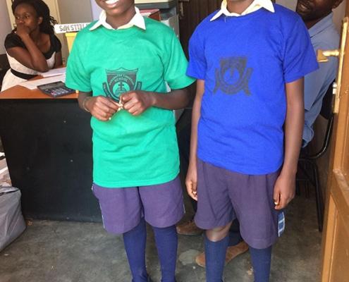 Two boys in donated sportswear