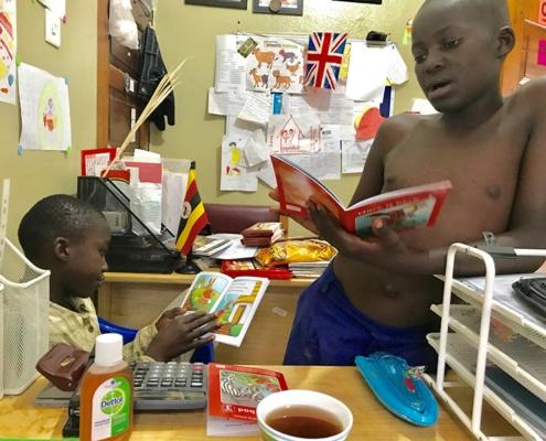 Two street children reading