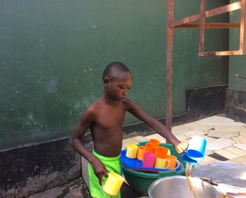 A street boy washing up
