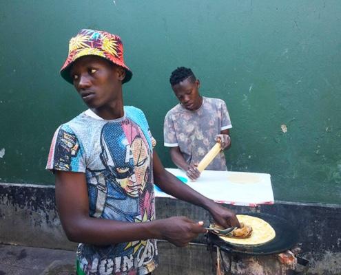 Street boys making chapatis