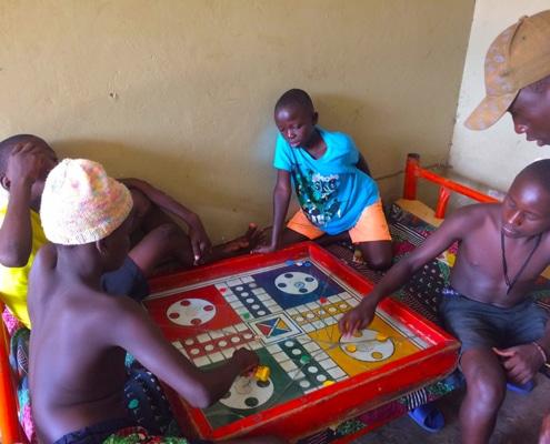 Boys playing ludo