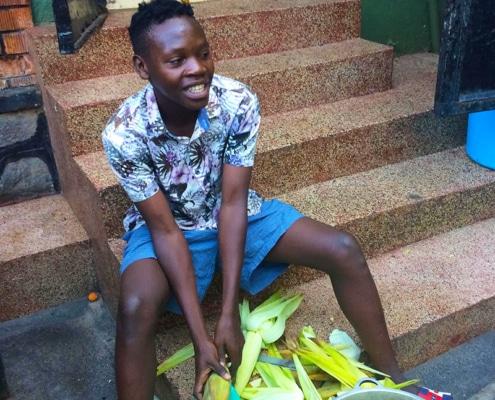 A street boy preparing food