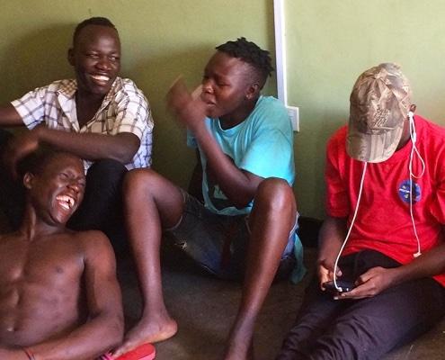 Ugandan street boys enjoying a joke