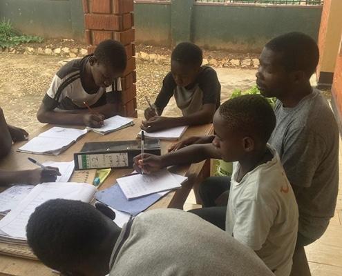 Street children being taught English
