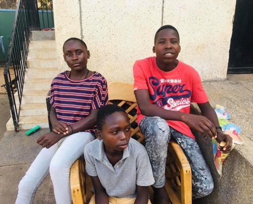 Three former street boys of Kampala