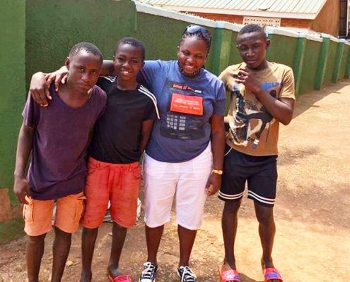 Three former street boys with Mary