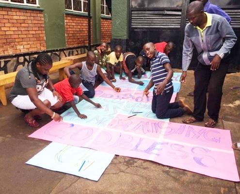 Street children making Thank you poster