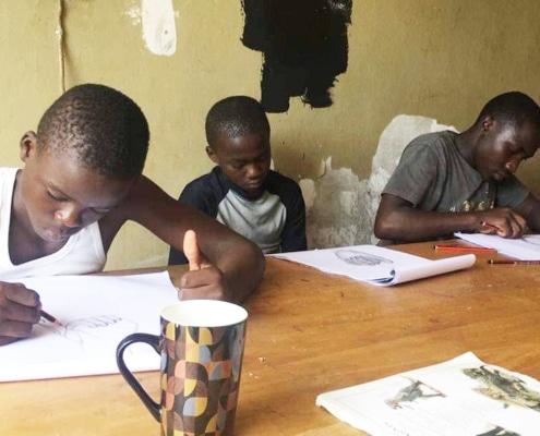 Boys doing art classes