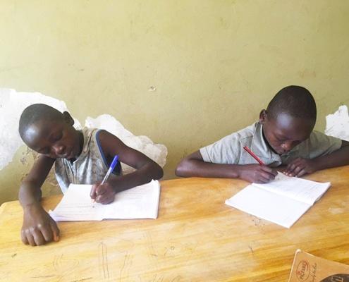 Two street children studying