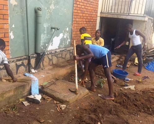 Former street boys doing gardening