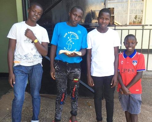 Four former street children