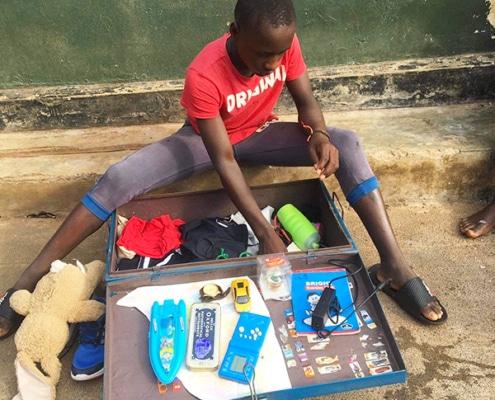 A street boy organising his things