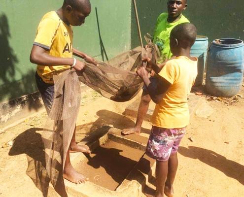 Street children sifting mud