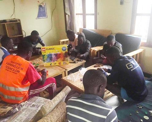 Street boys building with Lego