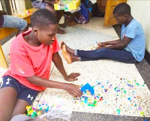 Street children enjoying Lego