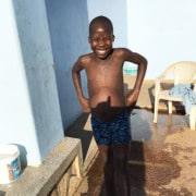 Former street boy enjoying swimming