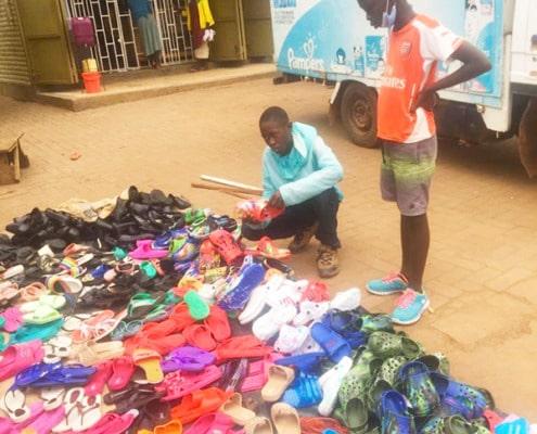 Street boys choosing sandals
